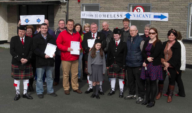 Members of the band with local politicians protesting last year