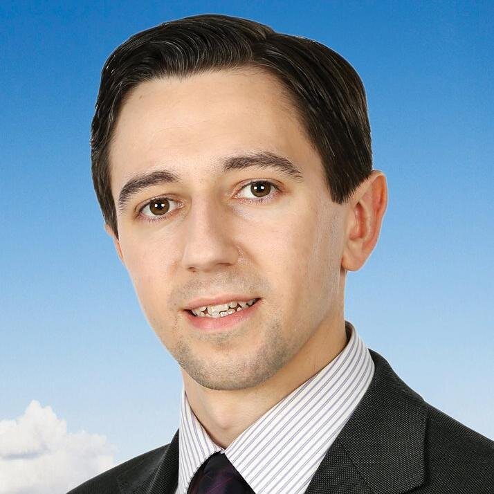 Simon Harris stands by Frances Fitzgerald