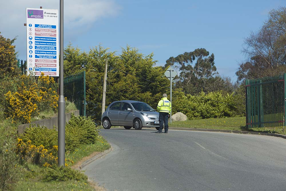 A security guard at the Greenstar recyling facility in Fassaroe, Bray, Co.Wicklow where the grim discovery was made.