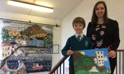 William O'Riordan (9) from St. Laurence's, Greystones with his teacher Karen Donoghue. Leinster Regional Winner with his painting Flying Buildings and Summer Igloo