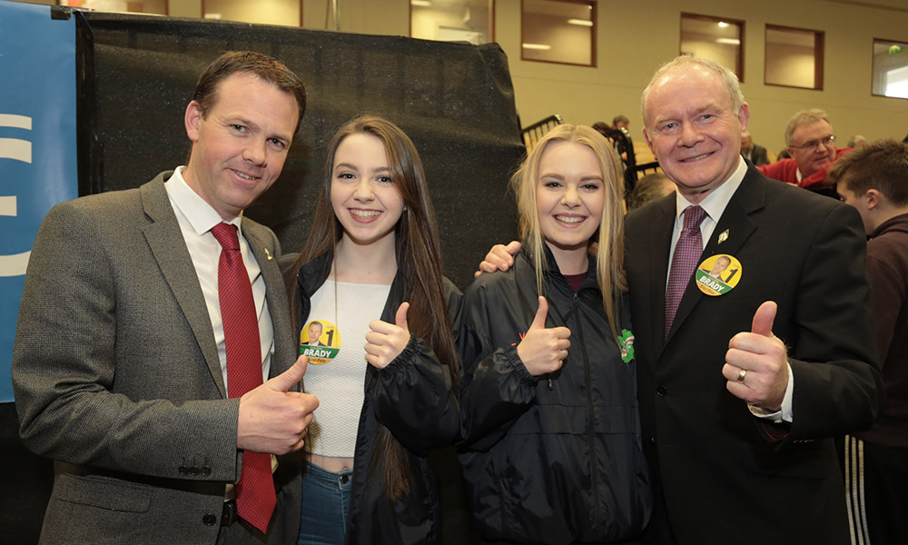 A thumbs up for John Brady from his daughters Siobhradh and Megan with Martin McGuinness, who dropped into the Shoreline Leisure Centre in Greystones to show his support for the Wicklow Sinn Fien candidate (Pic.Michael Kelly)