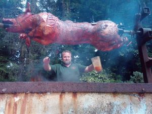 A pig being roasted at last years event